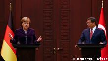 Angela Merkel et Ahmet Davutoglu lors d'une conférence de presse commune à Ankara