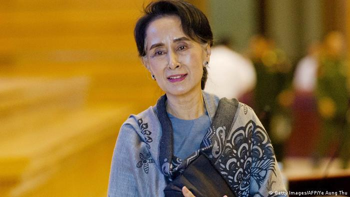 Chairperson of the National League for Democracy (NLD) Aung San Suu Kyi leaves after the last day of the parliament's lower house regular session in Naypyidaw on January 28