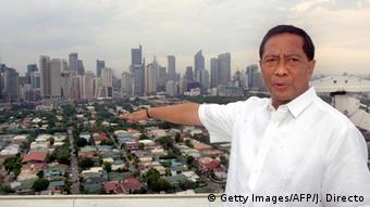 Standing at the top of city hall, Manila's Makati City mayor Jejomar 'Jojo' Binay gestures, 14 June 2005, as he shows off the skyscrapers of the Philippines' top corporations located within his jurisdiction (Photo: Getty Images/AFP/J. Directo)