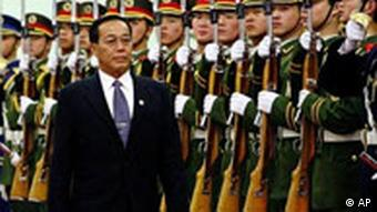 Former Myanmar Prime Minister Gen. Soe Win of Myanmar inspects the Chinese guard of honor
