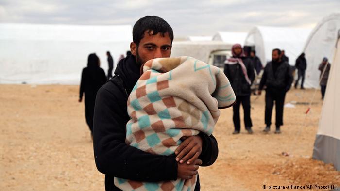 Біженці на сирійсько-турецькому кордоні