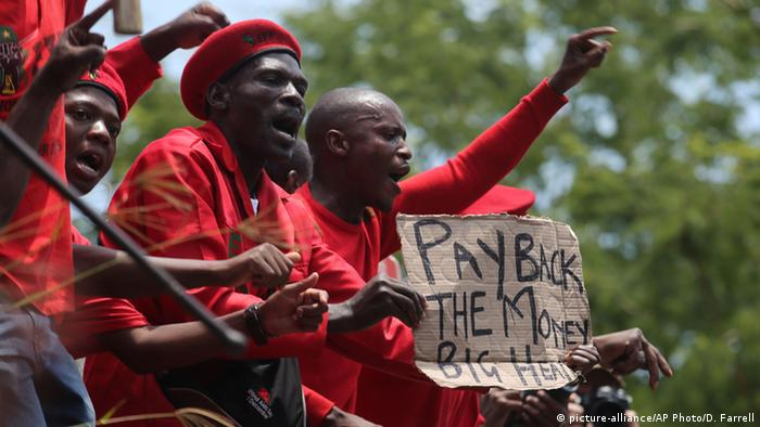 Demonstrators wearing red protest against Zuma