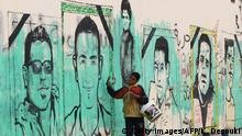 An Egyptian boy walks past graffiti depicting victims of the revolution near the interior ministry in Cairo on February 4, 2012. Police fired tear gas and birdshot at protesters in a third day of deadly clashes in Cairo, as anger at Egypt's ruling military boiled over after 74 people died in football-related violence. AFP PHOTO/KHALED DESOUKI (Photo credit should read KHALED DESOUKI/AFP/GettyImages) +++ (C) Getty Images/AFP/K. Desouki