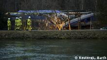10.02.2016 *** Rescue workers stand in front of two crashed trains near Bad Aibling in southwestern Germany, February 10, 2016. Ten people were killed and at least 81 injured on Tuesday when two passenger trains collided head-on at high speed in remote countryside in southern Germany. One passenger was still missing, police said, and 18 of those injured were in a serious condition. REUTERS/Lukas Barth © Reuters/L. Barth