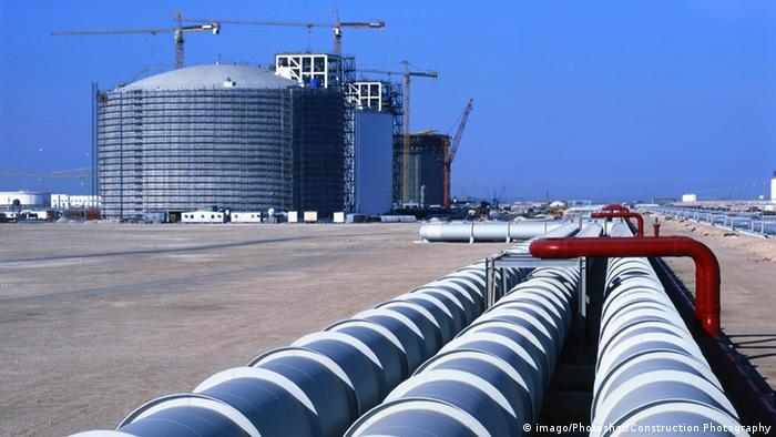 Gas tank and pipeline in Qatari desert