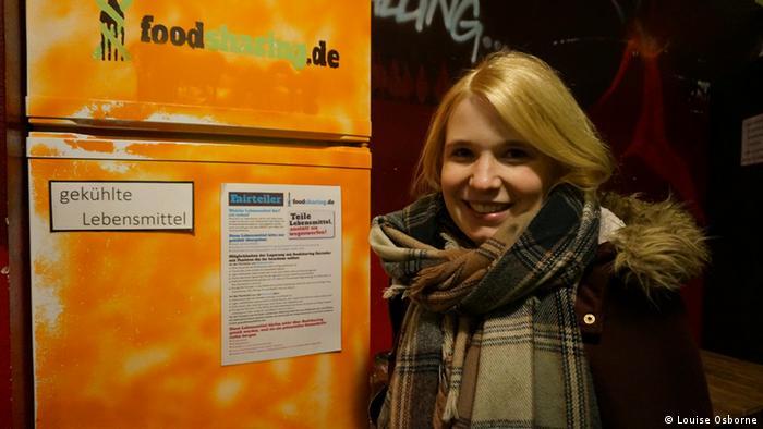 Sina Maatsch standing next to a community refrigerator in berlin (Photo: Louise Osborne)