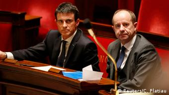 Prime Minister Valls (L) and Justice Minister Jean-Jacques Urvoas watch during parliament's constitutional reform vote.