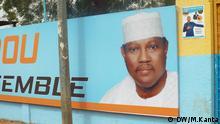 Titel: Wahlplakat für Hama Amadou Schlagworte: Niger, Wahlen, Hama Amadou, Lumana Fotograf: Mahaman Kanta (DW) Wann wurde das Bild gemacht?: 04.02.2016 Bildbeschreibung: Plakat der Oppositionspartei Moden-FA Lumana mit ihrem Präsidentschaftskandidaten Hama Amadou. Bildrechte: - Der Fotograf / die Fotografin ist (freie) Mitarbeiter(in) der DW, so dass alle Rechte bereits geklärt sind.