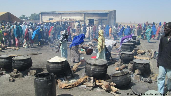 Displaced women prepare meals at an IDP cam