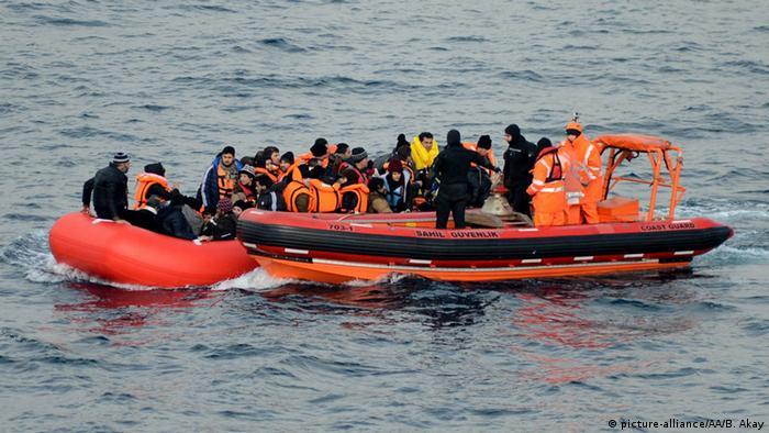 A Turkish coast guard vessel picks up a migrant boat in the Aegean Sea