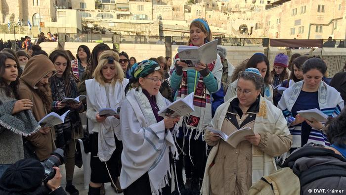 Women of the Wall pray in front of the Western Wall