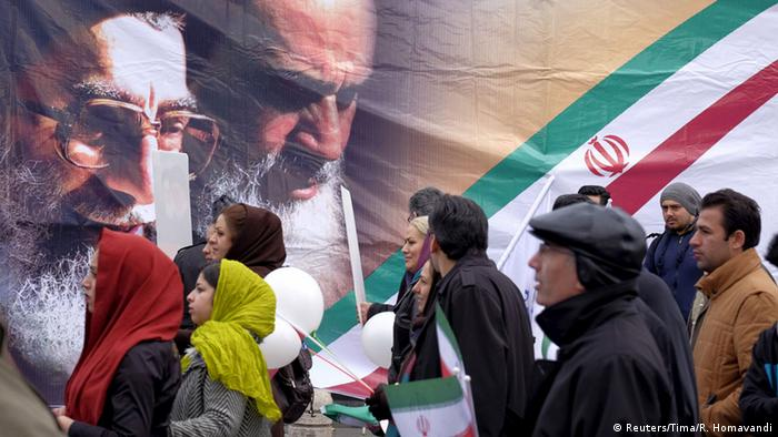 People passing in front of Khameini poster (Reuters/Tima/R. Homavandi)