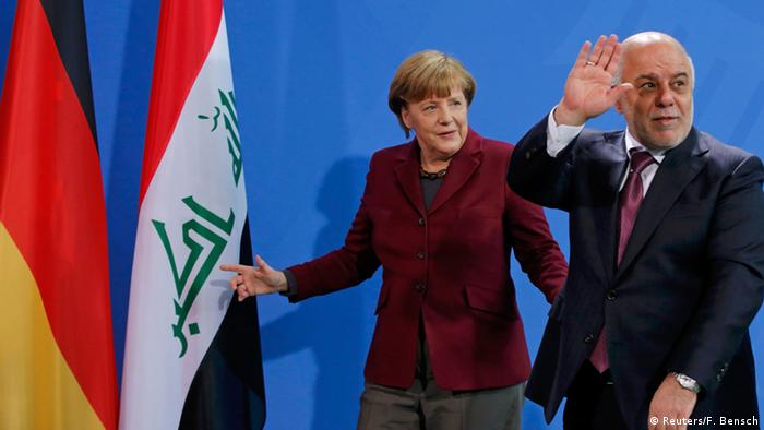 Iraq's Prime Minister Haidar al-Abadi and German Chancellor Angela Merkel leave after a news conference at the Chancellery in Berlin