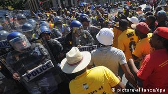 Protesters clash with police in Cape Town.