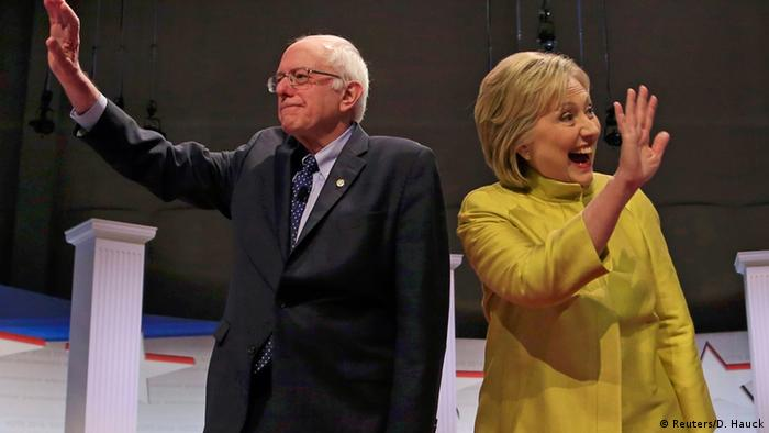 Hillary Clinton and Bernie Sanders wave to supporters
