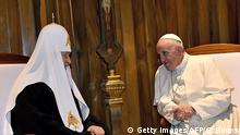Pope Francis (R) meets with the head of the Russian Orthodox Church, Patriarch Kirill, in Havana on February 12, 2016. Pope Francis and Russian Orthodox Patriarch Kirill kissed each other and sat down together Friday for the first meeting between their two branches of the church in nearly a thousand years. Francis, 79, in white robes and a skullcap and Kirill, 69, in black robes and a white headdress, exchanged kisses and embraced before sitting down smiling for the historic meeting at Havana airport. AFP PHOTO / GABRIEL BOUYS / AFP / GABRIEL BOUYS (Photo credit should read GABRIEL BOUYS/AFP/Getty Images) Getty Images/AFP/G. Bouys