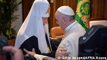 Pope Francis (R) and the head of the Russian Orthodox Church, Patriarch Kirill, greet each other during a historic meeting in Havana on February 12, 2016. Pope Francis and Russian Orthodox Patriarch Kirill kissed each other and sat down together Friday for the first meeting between their two branches of the church in nearly a thousand years. Francis, 79, in white robes and a skullcap and Kirill, 69, in black robes and a white headdress, exchanged kisses and embraced before sitting down smiling for the historic meeting at Havana airport. AFP PHOTO / ADALBERTO ROQUE / AFP / POOL / ADALBERTO ROQUE (Photo credit should read ADALBERTO ROQUE/AFP/Getty Images) Getty Images/AFP/A.Roque Getty Images/AFP/G. Bouys