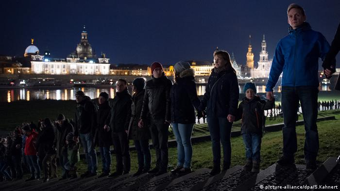 People holding hands at Dresden firebombing memorial