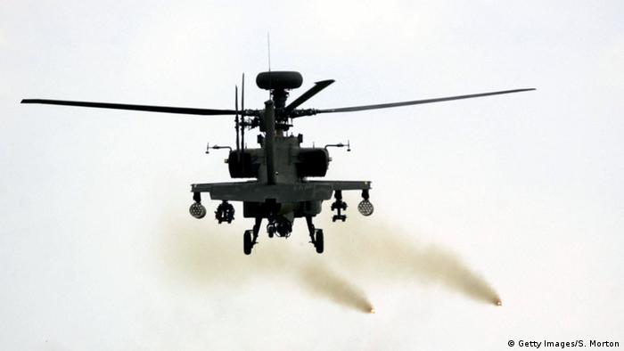 An Apache Longbow helicopter fires two rockets during a training exercise
