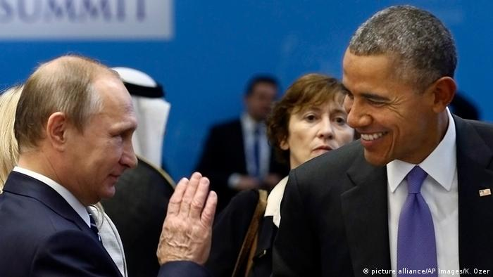 US President Barack Obama, right, talks with Russian President Vladimir Putin.