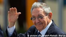Cuba's President Raul Castro waves to reporters from the tarmac of Jose Marti International airport in Havana, Cuba, Sunday, Feb. 14, 2016. Castro was at the airport to say farewell to Russian Patriarch Kirill, who concluded a four-day visit to Cuba including a meeting with Pope Francis and former Cuban leader Fidel Castro. (AP Photo/Desmond Boylan)