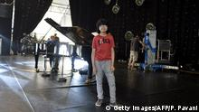 12-year-old Indonesian jazz pianist Joey Alexander stands on the main stage of the 'Jazz in Marciac' festival prior to his perfomance on August 10, 2015 in Marciac, southwestern France. AFP PHOTO/PASCAL PAVANI (Photo credit should read PASCAL PAVANI/AFP/Getty Images) +++ (C) Getty Images/AFP/P. Pavani