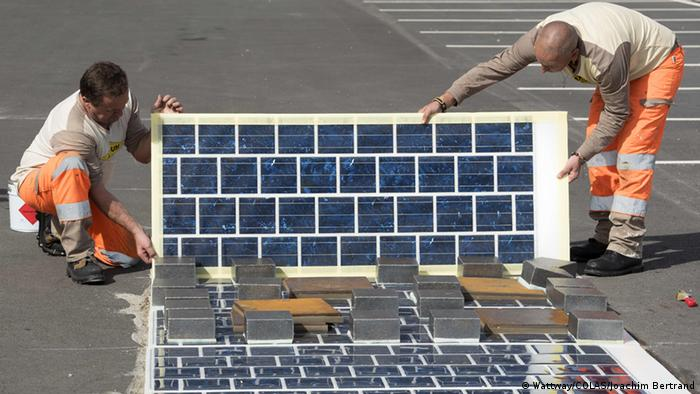Wattway promotional photo showing solar road being installed (Photo: COLAS - Joachim Bertrand)