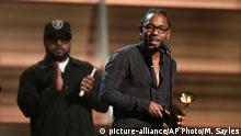 Kendrick Lamar accepts the award for best rap album for ¿To Pimp A Butterfly¿ x at the 58th annual Grammy Awards on Monday, Feb. 15, 2016, in Los Angeles. (Photo by Matt Sayles/Invision/AP)