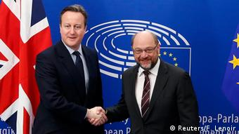 Britain's Prime Minister David Cameron poses with European Parliament President Martin Schulz (R) at the EU Parliament in Brussels.