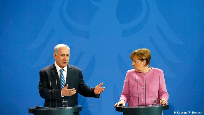 Israel Prime Minister Benjamin Netanyahu speaks at a joint press conference with German Chancellor Angela Merkel