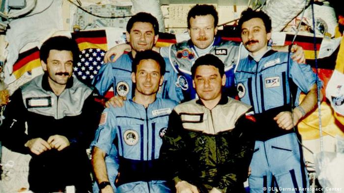 German astronaut Reinhold Ewald with colleagues at the station