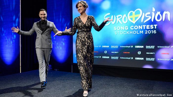 Mans Zelmerlow and Petra Mede with the ESC 2016 logo