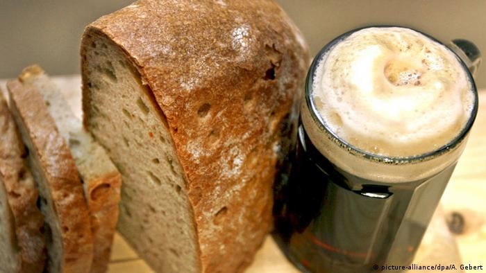 Bread and a glass of dark beer on a table