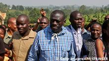 Ugandas opposition leader Kizza Besigye arrives at a polling station to vote in his home town of Rukungiri, some 400 kilometres west of the capital Kampala on February 18, 2016, during presidential and parliamentary elections. Ugandan police fired tear gas to disperse furious voters in the capital Kampala on February 18 as the election commission apologised for hours-long delays in delivering ballot papers in some areas. President Yoweri Museveni is widely predicted to win a fifth term, with the 71-year-old former rebel fighter who seized power in 1986 entering his fourth decade in power. The strongest among Museveni's seven challengers is Kizza Besigye, 59, who is making his fourth run at the presidency and ended his campaign by claiming the election would be neither free nor fair. / AFP / STRINGER (Photo credit should read STRINGER/AFP/Getty Images)