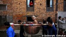19.02.2016 ***** A devotee is carried around town in a vessel as part of rituals during the Swasthani Bratakatha festival at Thecho in Lalitpur, Nepal, February 19, 2016. During the month long festival, devotees recite one chapter of a Hindu tale daily from the 31-chapter sacred Swasthani Brata Katha book that is dedicated to God Madhavnarayan and Goddess Swasthani, alongside various other gods and goddess and the miraculous feats performed by them. The devotees also go on pilgrimages to various temples, perform religious rituals, take a holy bath in the rivers and fast for a month, especially among women who believe fasting helps in their family's well-being or in getting them a good husband. REUTERS/Navesh Chitrakar TPX IMAGES OF THE DAY © Reuters/N. Chitrakar