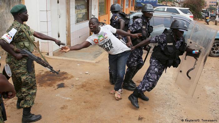 Security forces arrest a man