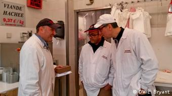 Philippe Zribi (l), who runs his family's kosher butcher shop, with butchers Mostafa Makhoukh and Abdel Haq