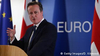 Prime Minister David Cameron addresses media after finalizing Britain's special status talks in Brussels.