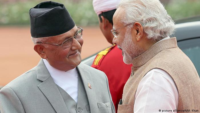 Indian Prime Minister Narendra Modi (R) welcomes Nepalese Prime Minister, Khadga Prasad Sharma Oli ,during a ceremonial reception in New Delhi on February 2016