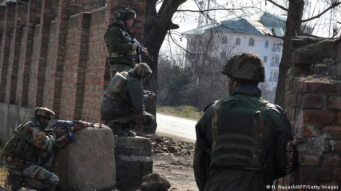 Indian army soldiers take positions against militants on the outskirts of Srinagar