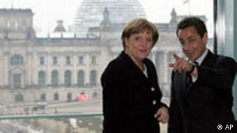Chancellor Angela Merkel, left, welcomes French Interior Minister Nicolas Sarkozy, right, for a private talk at Berlin Chancellery Thursday, Feb. 16, 2006