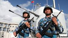 09.02.2016 **** REFILE - ADDING RESTRICTION Soldiers of China's People's Liberation Army (PLA) Navy stand guard in the Spratly Islands, known in China as the Nansha Islands, February 10, 2016. REUTERS/Stringer ATTENTION EDITORS - THIS PICTURE WAS PROVIDED BY A THIRD PARTY. THIS PICTURE IS DISTRIBUTED EXACTLY AS RECEIVED BY REUTERS, AS A SERVICE TO CLIENTS. CHINA OUT. NO COMMERCIAL OR EDITORIAL SALES IN CHINA. @ Reuters