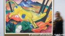 A visitor views the painting The Yellow Cow from 1911 by Franz Marc at the art museum in Bonn, Germany, 23 September 2014. The exhibition August Macke and Franz Marc. An friendship between artists cabn be visited at Art Museum Bonn from 25 September 2014 till 01 January 2015. Photo: FEDERICO GAMBARINI/DPA Bildergalerie Blauer Reiter © picture-alliance/dpa/F. Gambarini