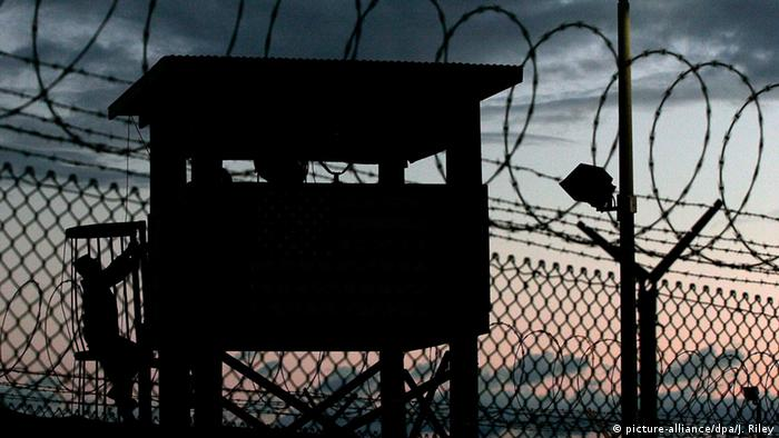 The silhouette of a watch tower at Camp Delta at Guantanamo Bay