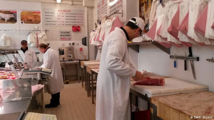 A butcher at work at Boucherie de L'Argonne in Paris