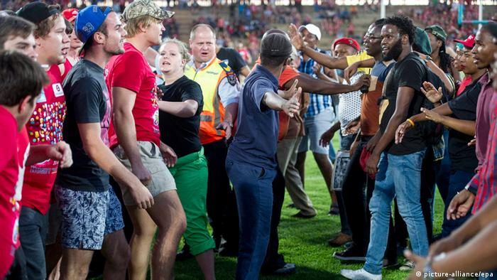 Students clashing during a protest at a university rugby union match in Bloemfontein(EPA/STR)