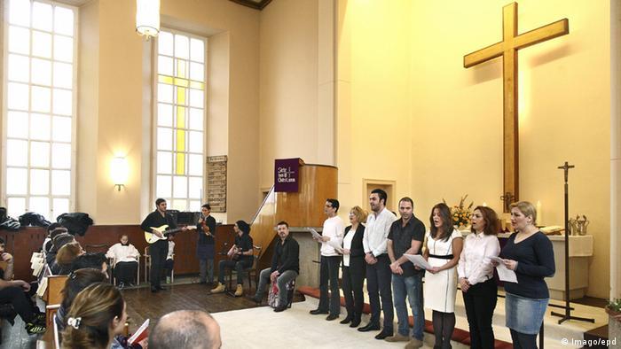Deutschland Berlin Taufe Flüchtlinge aus Iran