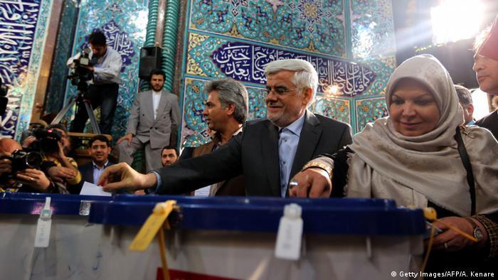 Iran Wahlen Wähler (Getty Images/AFP/A. Kenare)