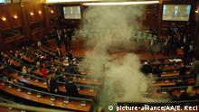26.02.2016+++ PRISTINA, KOSOVO - FEBRUARY 26: Members of Kosovo's Parliament leave the session after opposition lawmakers release a tear gas canister disrupting a parliamentary session in Pristina, Kosovo on February 26, 2016. Lawmakers were debating on whether to anoint Hashim Thaci, foreign minister, as the country's next president. Erkin Keci / Anadolu Agency +++ (C) picture-alliance/AA/E. Keci