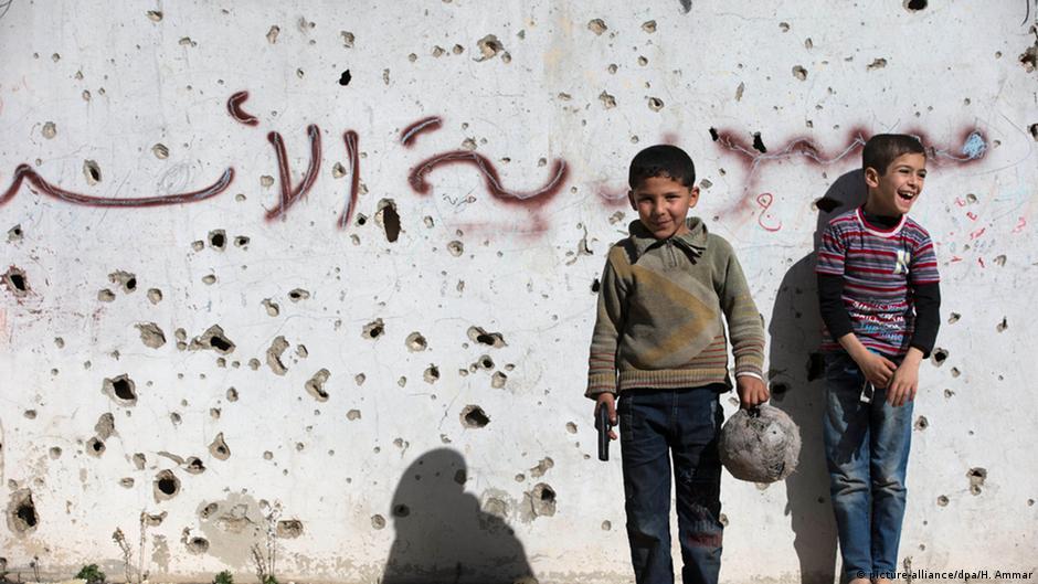 Το όνομα του συρου πρόεδρου γραμμένο σε τοίχο στην πόλη Χομς